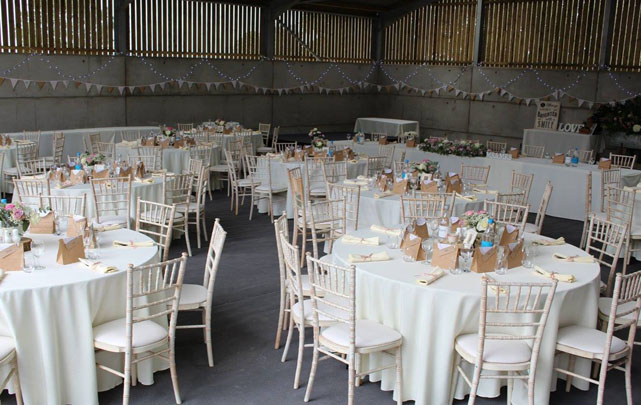 Barn Weddings and Furniture Hire Marquee with bunting